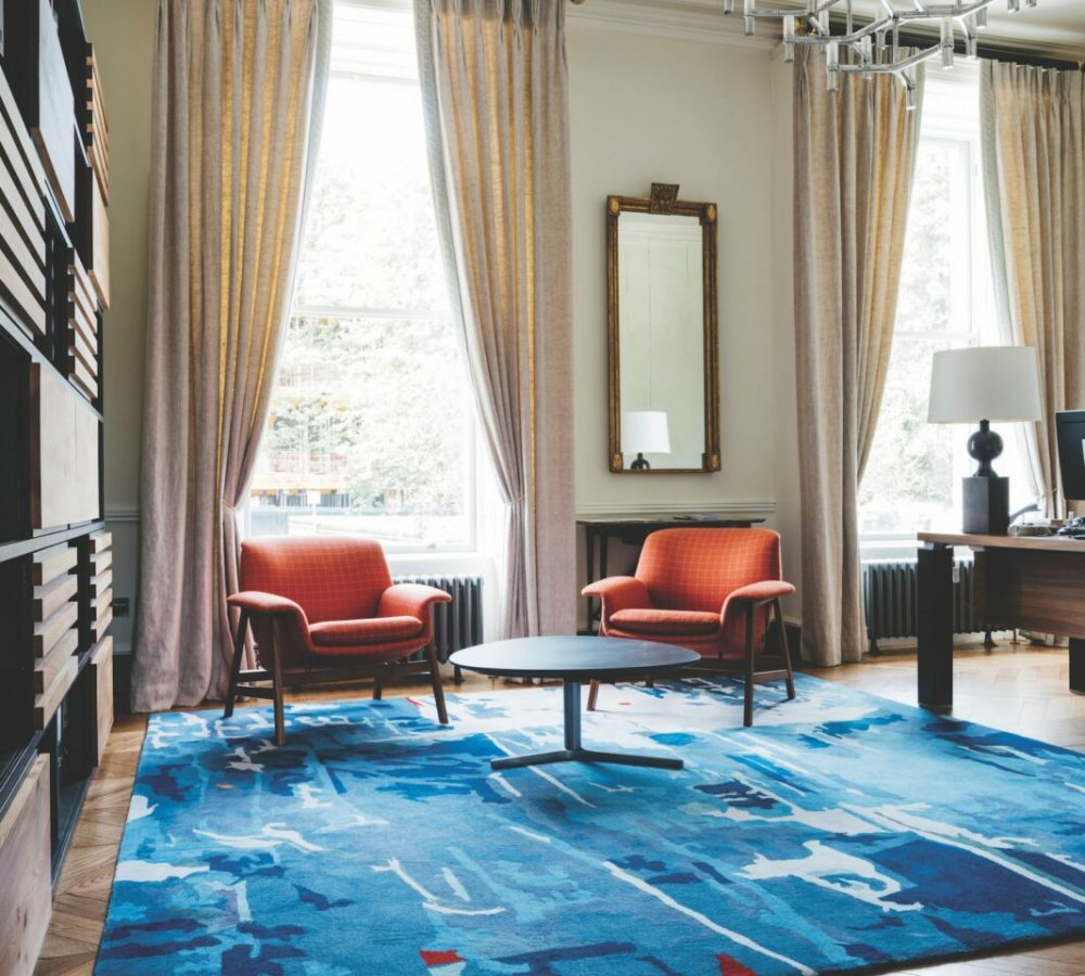 Office rug timber flooring desh shelving chairs retro